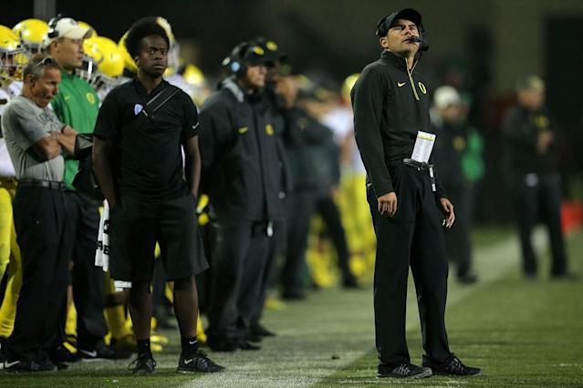 Oregon coach Mark Helfrich is on the hot seat as the Ducks are suffering a tough season. (Getty)