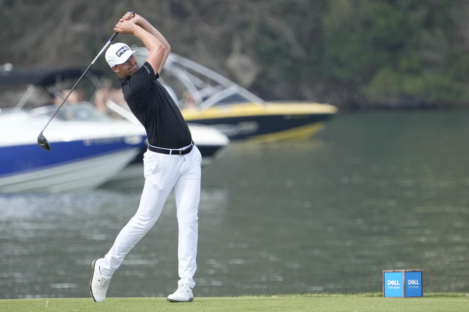 Victor Perez, of France, hits his tee shot on the 14th hole during a round of eight match at the Dell Technologies Match Play Championship golf tournament Saturday, March 27, 2021, in Austin, Texas. (AP Photo/David J. Phillip)