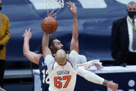 New York Knicks center Taj Gibson (67) and New Orleans Pelicans center Steven Adams (12) battle for a rebound in the first half of an NBA basketball game in New Orleans, Wednesday, April 14, 2021. (AP Photo/Gerald Herbert)