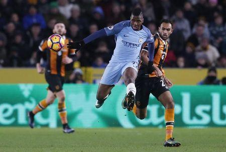 Manchester City's Kelechi Iheanacho in action with Hull City's Ahmed Elmohamady