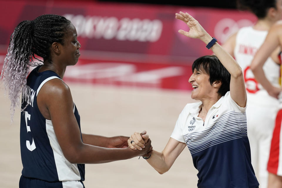 France head coach Valerie Garnier celebrates with Endene Miyem, left, after a women's basketball quarterfinal round game against Spain at the 2020 Summer Olympics, Wednesday, Aug. 4, 2021, in Saitama, Japan. (AP Photo/Charlie Neibergall)