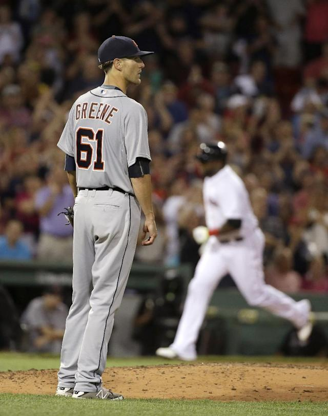 Boston Red Sox's David Ortiz, right, runs the bases toward home as Detroit Tigers starting pitcher Shane Greene, left, stands on the mound after Ortiz hit a three-run home in the fifth inning of a baseball game Sunday, July 26, 2015, in Boston. (AP Photo/Steven Senne)