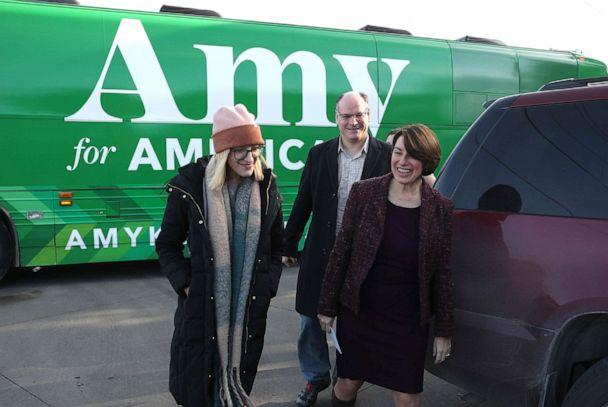 PHOTO: Democratic presidential candidate Sen. Amy Klobuchar (D-MN) arrives with husband John Bessler and daughter Abigail Bessler for a campaign stop, Dec. 27, 2019 in Humboldt, Iowa. (Joe Raedle/Getty Images)