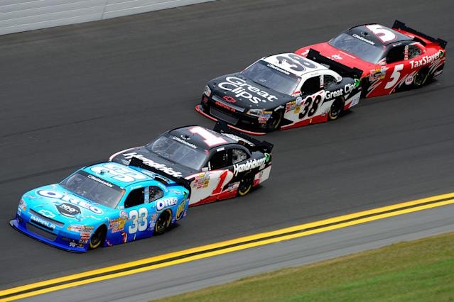 DAYTONA BEACH, FL - FEBRUARY 25: Tony Stewart, driver of the #33 Oreo/Ritz Chevrolet, is pushed by Kurt Busch, driver of the #1 HendrickCars.com Chevrolet, as Kasey Kahne, driver of the #38 Great Clips Chevrolet, is pushed by Dale Earnhardt Jr., driver of the #5 TaxSlayer.com Chevrolet, during the NASCAR Nationwide Series DRIVE4COPD 300 at Daytona International Speedway on February 25, 2012 in Daytona Beach, Florida. (Photo by John Harrelson/Getty Images for NASCAR)