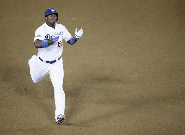 Los Angeles Dodgers' Yasiel Puig reacts after hitting an RBI triple during the fourth inning of Game 3 of the National League baseball championship series against the St. Louis Cardinals, Monday, Oct. 14, 2013, in Los Angeles. (AP Photo/Jae C. Hong)
