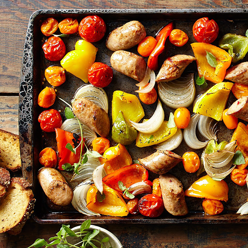 <p>Colorful peppers and tomatoes and sweet onion make this sausage dinner pop with fresh flavor. Roasting instead of sautéing makes this even easier for a busy weeknight.</p>