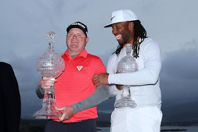 "<div class=""caption""> PEBBLE BEACH, CA - FEBRUARY 11: Ted Potter Jr. (L) and Larry Fitzgerald celebrate after winning the AT&T Pebble Beach Pro-Am at Pebble Beach Golf Links on February 11, 2018 in Pebble Beach, California. (Photo by Warren Little/Getty Images) </div> <cite class=""credit"">Warren Little</cite>"