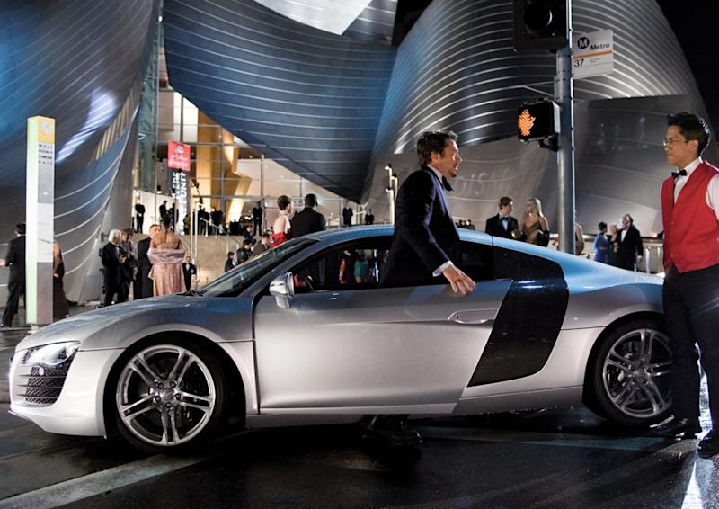 Robert Downey Jr. - as Tony Stark - with the Audi R8.