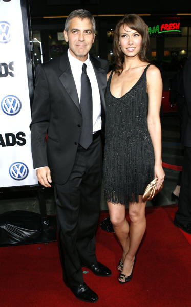 """FILE - In this March 11, 2008 file photo, George Clooney, left, and Sarah Larson arrive at the premiere of """"Leatherheads"""" in Los Angeles. Clooney, 52, Hollywood's most determined bachelor famous for a litany of fleeting loves, including Larson, has taken himself off the romantic market and proposed to 36-year-old attorney, Amal Alamuddin. A spokesman for the Oscar-winning actor and producer did not respond to requests for comment Monday, April 28, 2014. (AP Photo/Matt Sayles, file)"""