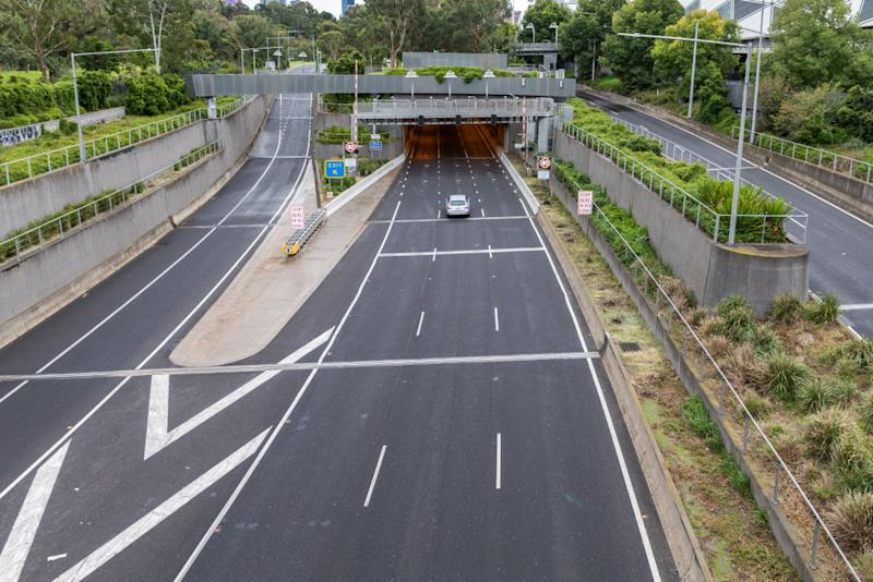 A lone car is seen on the empty city link Burnley tunnel tollway entrance. Source: Getty