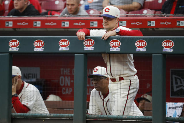 Cincinnati Reds manager David Bell stands in the dugout during the second inning of the team's baseball game against the Texas Rangers, Saturday, June 15, 2019, in Cincinnati. (AP Photo/John Minchillo)