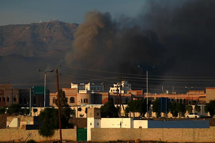 Smoke billows early in the morning on September 12, 2015, following an air-strike by the Saudi-led coalition targeting an arms depot in the Yemeni capital Sanaa (AFP Photo/Mohammed Huwais)