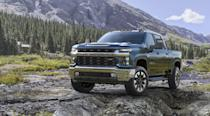 "<p>The <a href=""https://www.caranddriver.com/chevrolet/silverado-2500hd-3500hd"" rel=""nofollow noopener"" target=""_blank"" data-ylk=""slk:heavy-duty Chevy Silverado"" class=""link rapid-noclick-resp"">heavy-duty Chevy Silverado</a> variants are capable of more than just towing a farm's worth of hay and attending Future Farmers of America meetings, especially when equipped with the Z71 Off-Road package. Available exclusively with four-wheel drive, this setup is similar to that on the light-duty 1500 and brings a beefy front anti-roll bar and skid-plate protection for the two-speed transfer case. A set of twin-tube dampers enhances the suspension, and hill-descent control is added to help regulate downhill speed on steep slopes. Of course, the 2500/3500HD Z71 models' exteriors are emblazoned with Z71 badging, and 17- or 18-inch wheels wrapped with all-terrain tires are offered. This package can be paired with the standard 360-hp 6.0-liter V-8 or the thunderous 6.6-liter Duramax diesel V-8 that makes 910 lb-ft of torque.</p>"