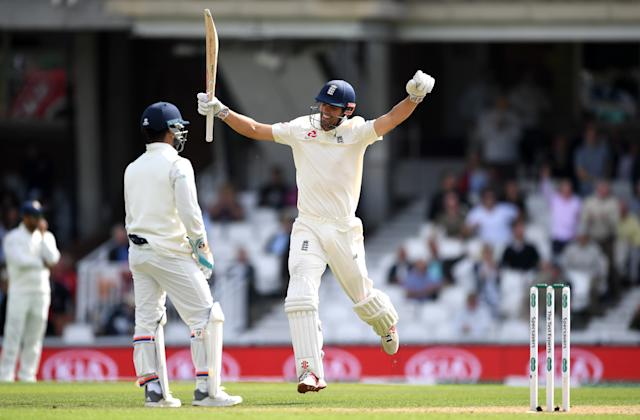 Alastair Cook celebrates after bringing up his final Test century with five otherthrows