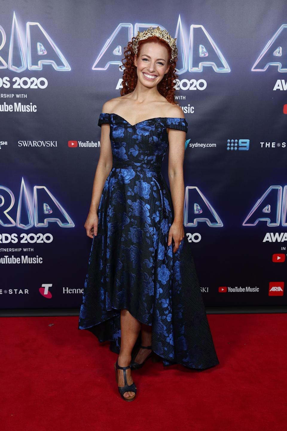 Emma Watkins wears a blue floral gown on the red carpet at the 2020 ARIA Awards at The Star on November 24, 2020 in Sydney, Australia.