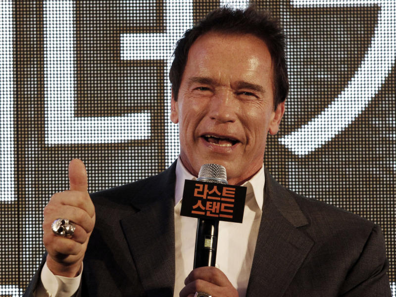 """Actor Arnold Schwarzenegger gestures during a press conference to promote his latest film """"The Last Stand"""" in Seoul, South Korea, Wednesday, Feb. 20, 2013. The movie will open on Thursday, Feb. 21, in South Korea.  (AP Photo Ahn Young-joon)"""