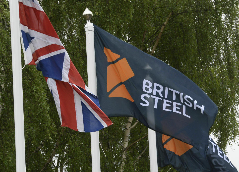 FILE - This June 1, 2016 file photo shows a flag with a British Steel logo at the entrance to the steelworks plant in Scunthorpe, England, now owned by British Steel. Britain's government pledged Tuesday May 21, 2019 to do its utmost to support British Steel amid reports the company is facing bankruptcy. (Anna Gowthorpe/PA via AP)