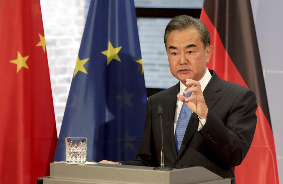 China's Foreign Minister Wang Yi addresses the media during a joint press conference with German Foreign Minister Heiko Maas as part of a meeting in Berlin, Germany, Tuesday, Sept. 1, 2020. (AP Photo/Michael Sohn, pool)