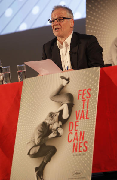 Artistic director Cannes Film Festival Thierry Fremaux attends a news conference to announce the 2013 festival line up in front of the Cannes International Film Festival poster for the upcoming 66th edition featuring U.S. actors Paul Newman and Joanne Woodward, in Paris, Thursday April 18, 2013. The festival will run from May 15 to May 26, 2013. (AP Photo/Francois Mori)