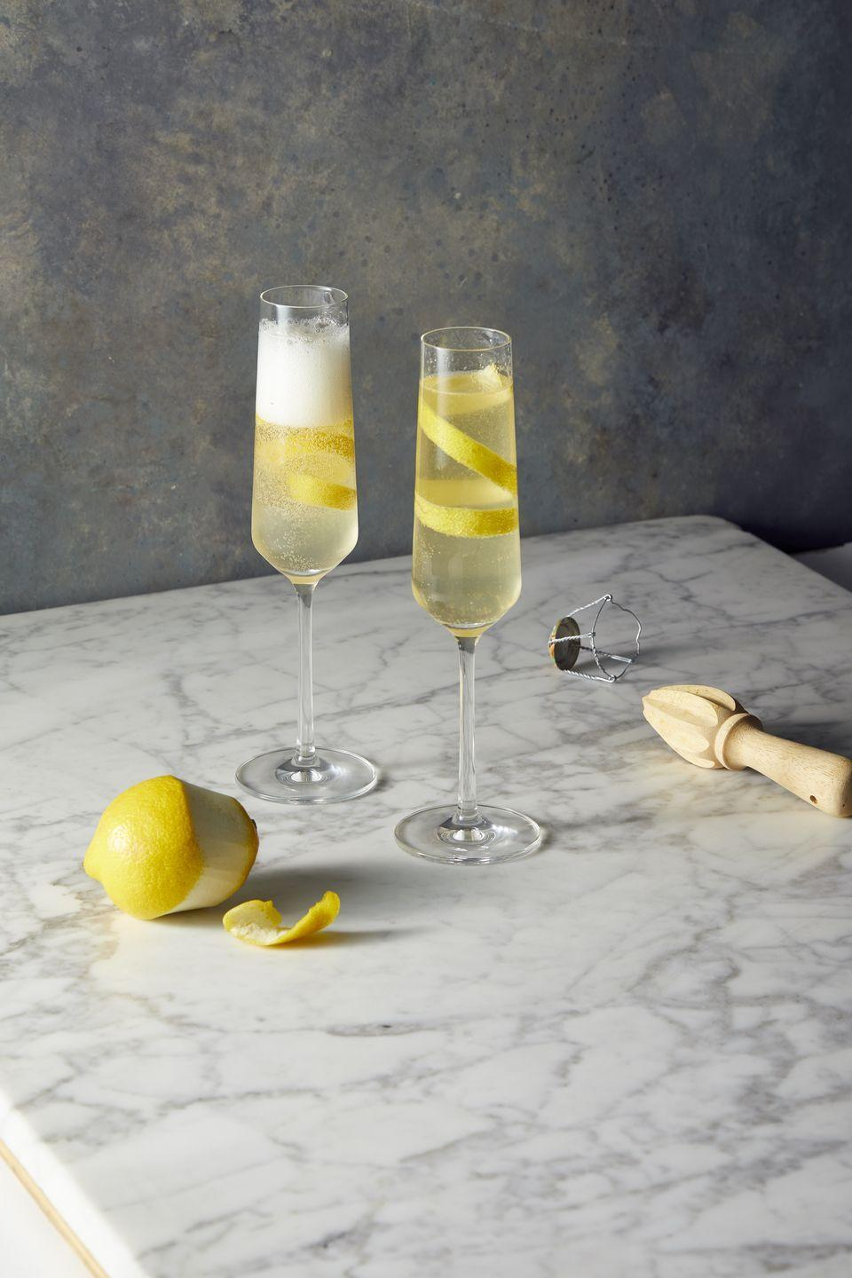 """<p>Reach for a flute if you fancy a tart, bubbly beverage, originally developed in Paris in the 1920s. In a cocktail shaker filled with ice, shake 2 oz gin, ¾ oz lemon juice and ½ oz simple syrup. Strain into a flute and top with 2 oz sparkling wine. Serve with a lemon twist.<strong><br></strong></p><p><strong>RELATED:</strong> <a href=""""https://www.goodhousekeeping.com/food-recipes/g29833730/best-champagne-cocktails/"""" rel=""""nofollow noopener"""" target=""""_blank"""" data-ylk=""""slk:10 Champagne Cocktails That Are So Good You'll Never Stop Saying &quot;Cheers&quot;"""" class=""""link rapid-noclick-resp"""">10 Champagne Cocktails That Are So Good You'll Never Stop Saying """"Cheers""""</a></p>"""