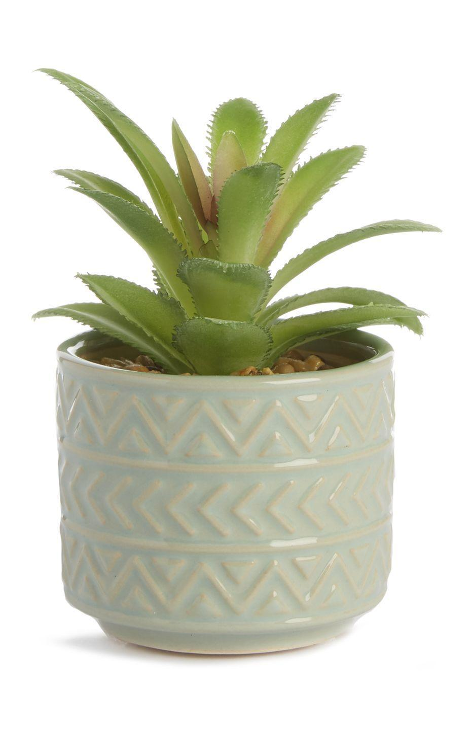 <p>Small faux plant with green pot, £3.50</p>