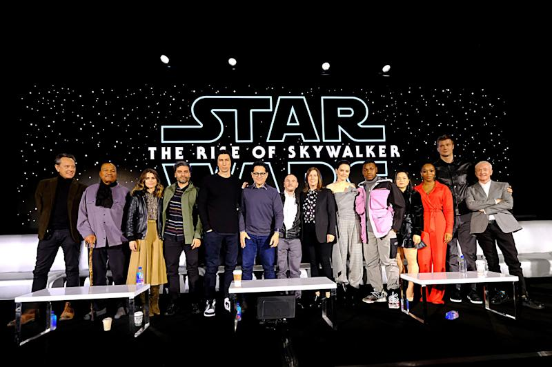 """Actors Richard E. Grant, Billy Dee Williams, Keri Russell, Oscar Isaac, Adam Driver, writer/director J.J. Abrams, co-writer Chris Terrio, producer and president of Lucasfilm Kathleen Kennedy, and actors Daisy Ridley, John Boyega, Kelly Marie Tran, Naomi Ackie, Joonas Suotamo and Anthony Daniels participate in the global press conference for """"Star Wars: The Rise of Skywalker"""" at the Pasadena Convention Center on Dec. 4, 2019. (Photo: Alberto E. Rodriguez via Getty Images)"""