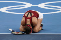 Belinda Bencic, of Switzerland, reacts after defeating Elena Rybakina, of Kazakhstan, during the semifinals of the tennis competition at the 2020 Summer Olympics, Thursday, July 29, 2021, in Tokyo, Japan. (AP Photo/Seth Wenig)