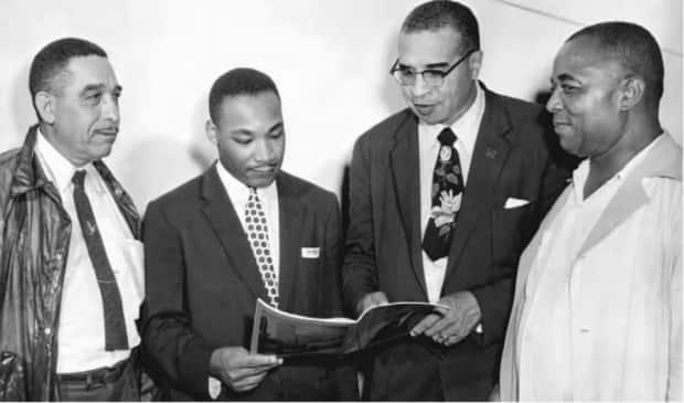 Civil rights leader Martin Luther King Jr., second from left, attends Emancipation Day celebrations in Windsor, Ont., in 1956. Emancipation Day — now officially recognized by the federal government — marks Aug. 1, 1834, when slavery was abolished in British colonies, including Canada. (Silver Wave Film Festival - image credit)