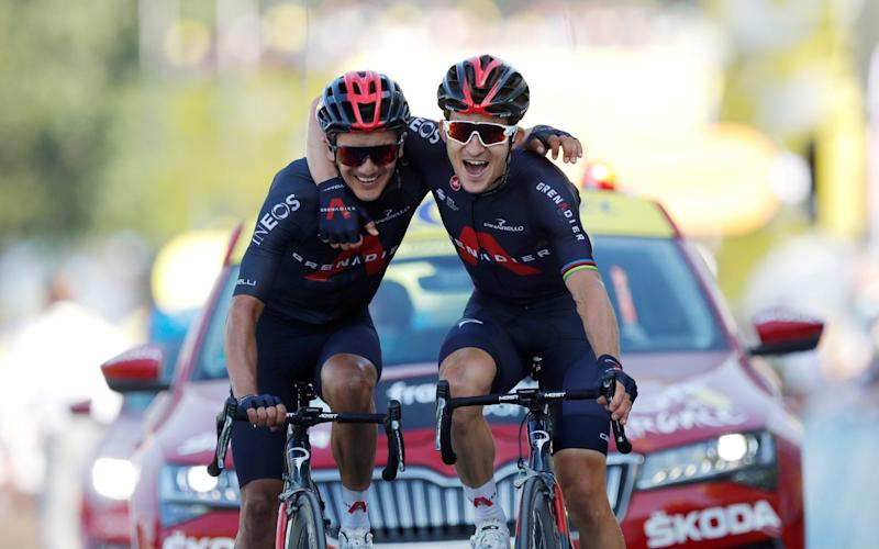 Team INEOS Grenadiers riders Michal Kwiatkowski of Poland and Richard Carapaz of Ecuador celebrate as they cross the finish line -Tour de France verdict: Michal Kwiatkowski and Richard Carapaz's arm-in-arm finish was perfect riposte to Ineos doubters - REUTERS