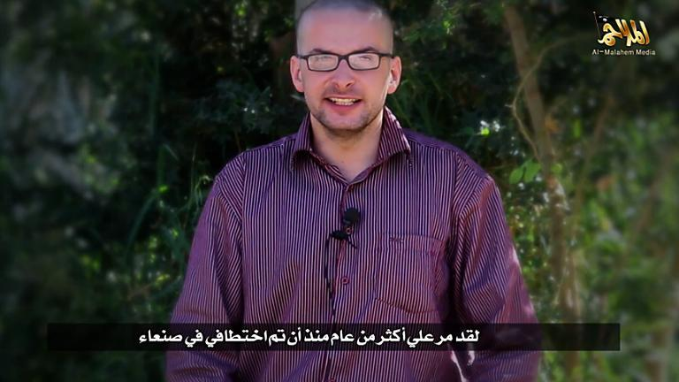 A file video grab taken from a propaganda video released by al-Malahem Media on December 4, 2014 purportedly shows US hostage Luke Somers