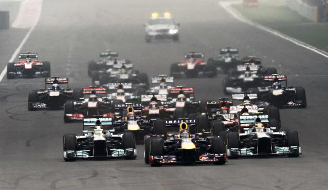 Red Bull Formula One driver Sebastian Vettel of Germany leads the field at the start of the Indian F1 Grand Prix at the Buddh International Circuit in Greater Noida, on the outskirts of New Delhi, October 27, 2013. REUTERS/Adnan Abidi (INDIA - Tags: SPORT MOTORSPORT F1)
