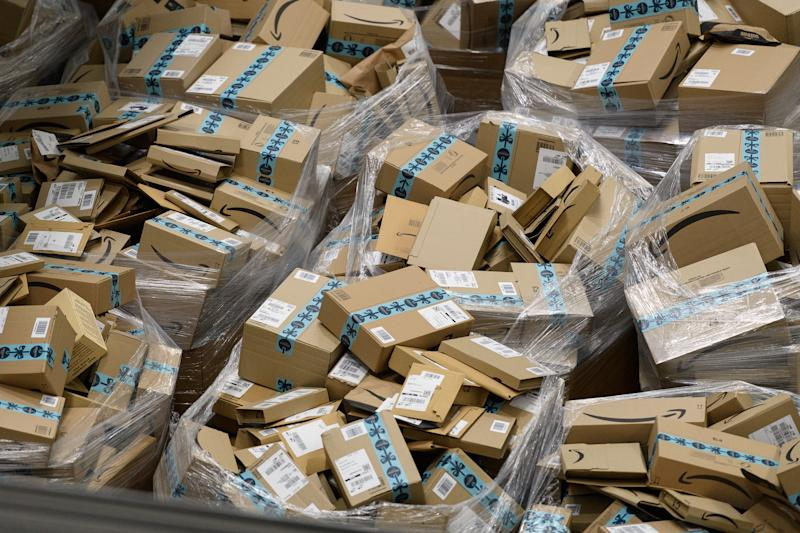 """HEMEL HEMPSTEAD, ENGLAND - NOVEMBER 14: Completed customer orders are seen in their boxes, awaiting delivery, at the Amazon Fulfillment Centre on November 14, 2018 in Hemel Hempstead, England. The online retailer Amazon will again take part in the now-traditional """"Black Friday"""" sales this year, with reductions available from 16-25 November. (Photo by Leon Neal/Getty Images) (Photo by Leon Neal/Getty Images)"""