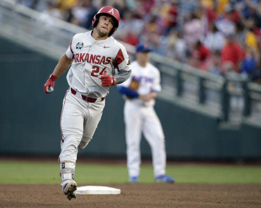 Arkansas' Dominic Fletcher (24) rounds the bases after hitting a solo home run against Florida in the fifth inning of an NCAA College World Series baseball game in Omaha, Neb., Friday, June 22, 2018. (AP Photo/Nati Harnik)