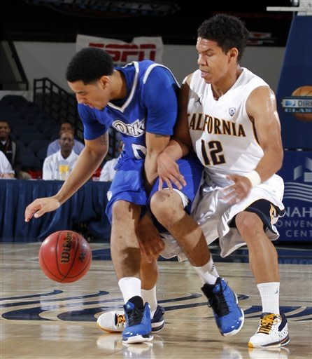 Drake guard Kori Babineaux, left, blocks California guard Brandon Smith (12) from the stealing the ball during the first half of their NCAA college basketball game in the first round of the DirecTV Classic in Anaheim, Calif., Thursday, Nov. 22, 2012. (AP Photo/Alex Gallardo)