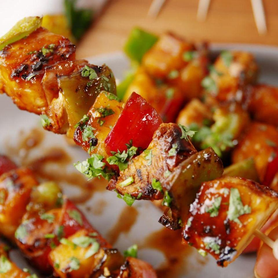 "<p>Say aloha to your new favourite BBQ skewers. </p><p>Get the <a href=""https://www.delish.com/uk/cooking/recipes/a32399748/hawaiian-chicken-skewers-recipe/"" rel=""nofollow noopener"" target=""_blank"" data-ylk=""slk:Hawaiian Chicken Skewers"" class=""link rapid-noclick-resp"">Hawaiian Chicken Skewers</a> recipe.</p>"