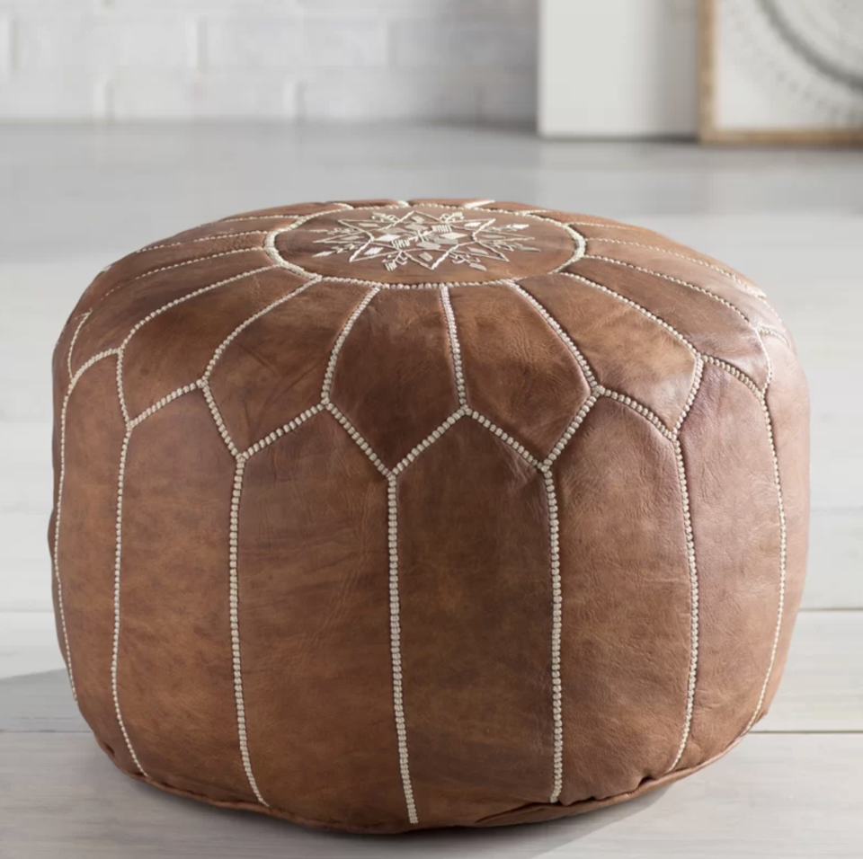 No one has to know you didn't get this leather pouf while on your travels abroad. (Photo: Wayfair)