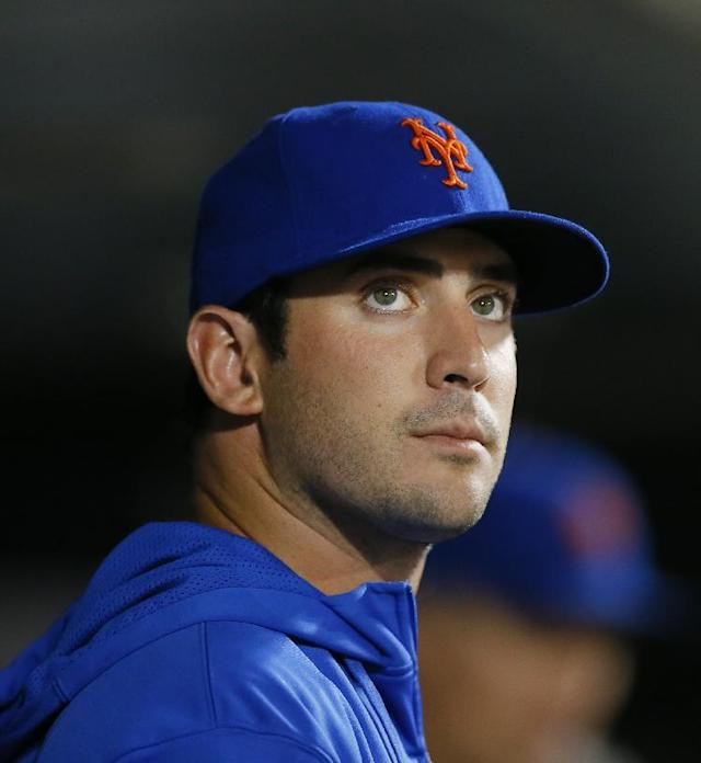 New York Mets pitcher Matt Harvey stands in the Mets dugout watching the game in the seventh inning during a baseball game against the Philadelphia Phillies at Citi Field, Monday, Aug. 26, 2013, in New York. It was announced earlier that he had a torn ligament and could miss next season. (AP Photo/Paul J. Bereswill)