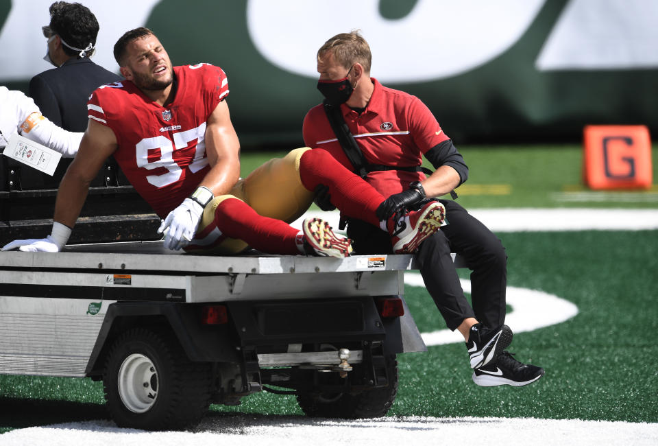 Nick Bosa is carted off the field after sustaining an injury against the Jets at MetLife Stadium.