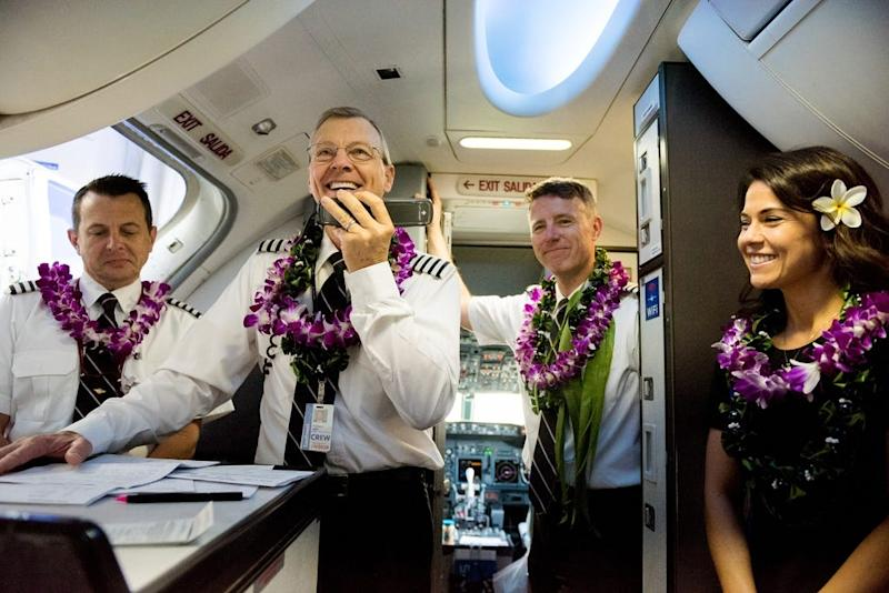Capt. Michael Styer greets passengers on Southwest Airlines' inaugural Hawaiian flight to Honolulu, Hawaii, from Oakland, Calif., earlier this year.