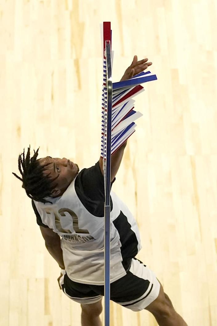 Keon Johnson participates in vertical leap at the NBA draft combine.