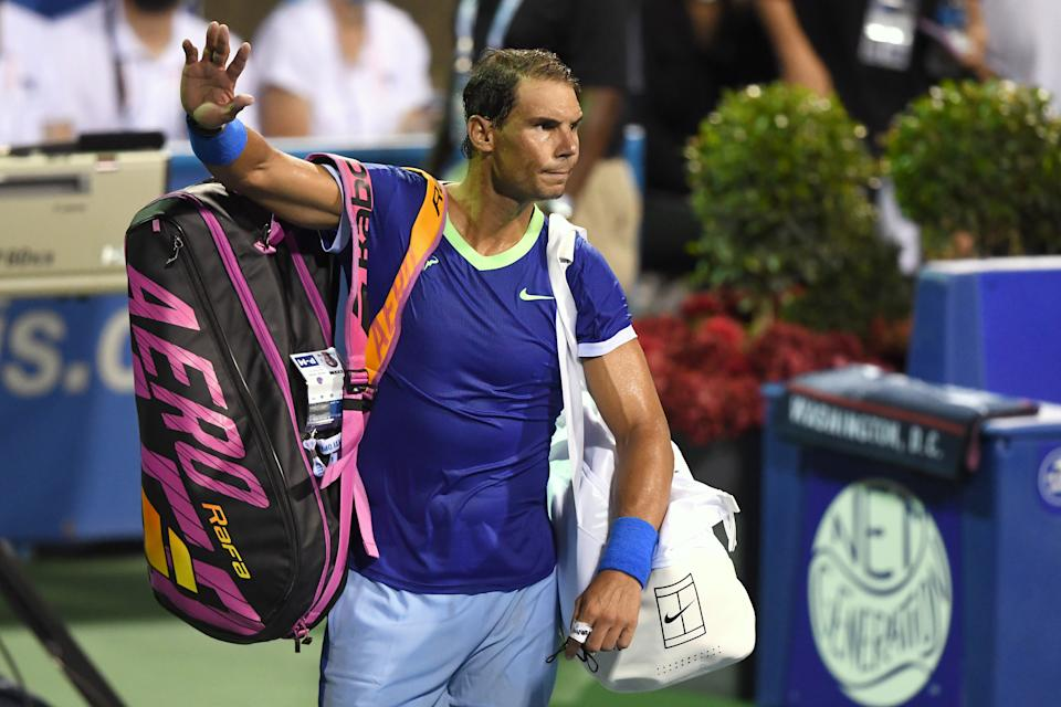 WASHINGTON, DC - AUGUST 05:  Rafael Nadal of Spain waves to the crowd after losing a match to Lloyd Harris of South Africa on Day 6 during the Citi Open at Rock Creek Tennis Center on August 5, 2021 in Washington, DC.  (Photo by Mitchell Layton/Getty Images)