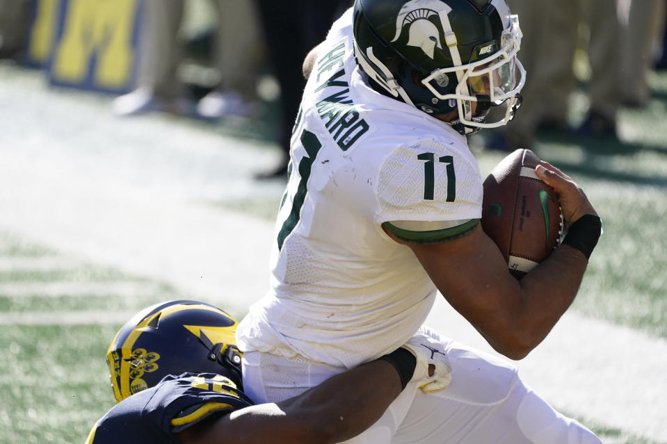 Michigan State running back Connor Heyward (11) is tackled in the end zone after a reception for a touchdown during the first half of an NCAA college football game against Michigan, Saturday, Oct. 31, 2020, in Ann Arbor, Mich. (AP Photo/Carlos Osorio)