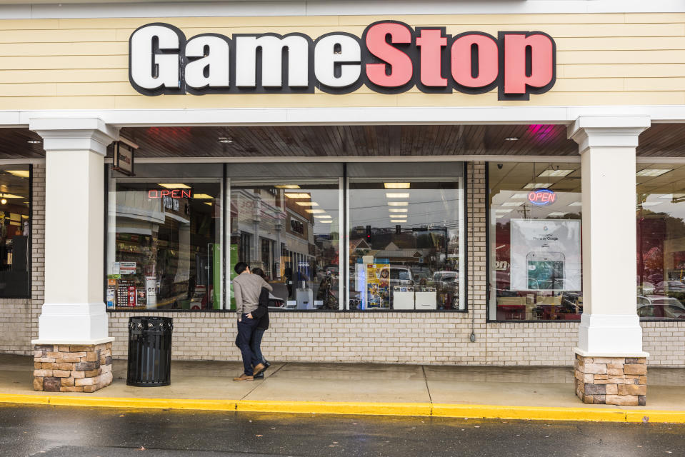 Fairfax, United States - November 30, 2016: Gamestop store facade exterior selling games with couple walking by