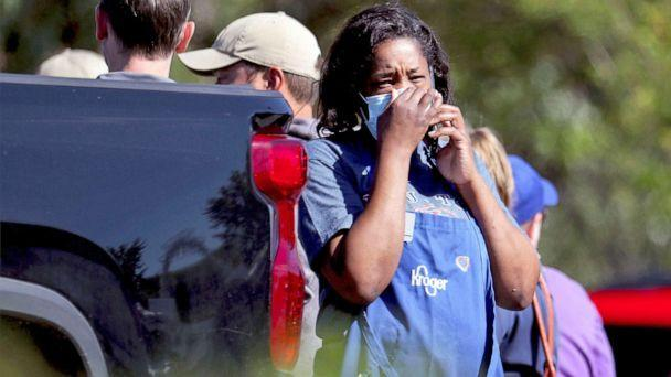 PHOTO: A Kroger employee talks on a cellphone following a shooting at a Kroger's grocery store in Collierville, Tenn., Sept. 23, 2021. (Patrick Lantrip/AP)