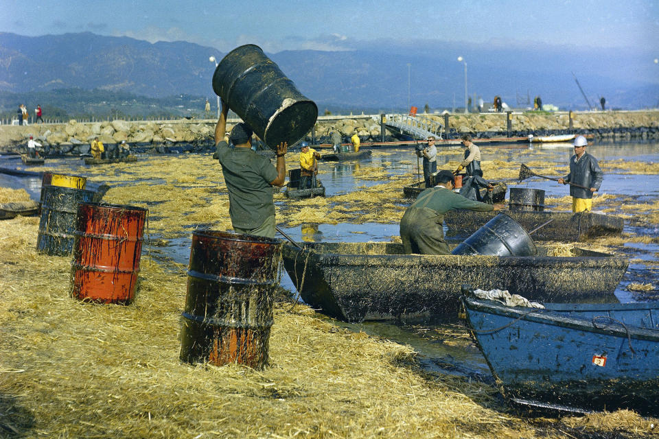 FILE - In this Feb. 7, 1969, file photo, workers collect oil-soaked straw from the beach at Santa Barbara, Calif., following a leak from an off-shore well that covered area beaches. The oil spill more than a generation ago helped give rise to the modern environmental movement itself. (AP Photo/File)