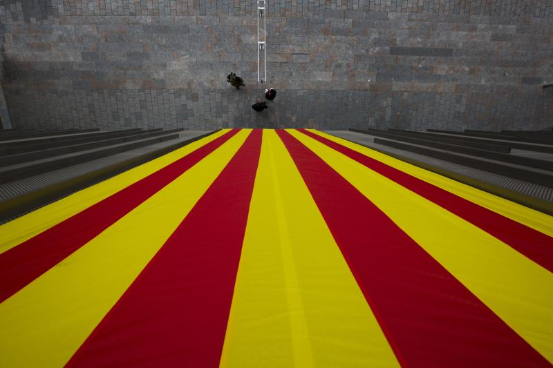 A Catalan flag hangs from a Catalan government building in Girona, Spain, Friday, Dec. 2, 2017. Elections in Catalonia have failed to clarify the restive region's immediate future, exposing a deep and broad split between those for and against independence from Spain. (AP Photo/Bernat Armangue)
