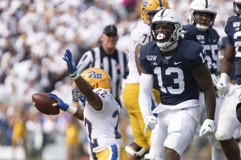 Penn State linebacker Ellis Brooks (13) celebrates after stopping Pittsburgh running back Vincent Davis (22) in the second half of an NCAA college football game in State College, Pa., on Saturday, Sept. 14, 2019. (AP Photo/Barry Reeger)