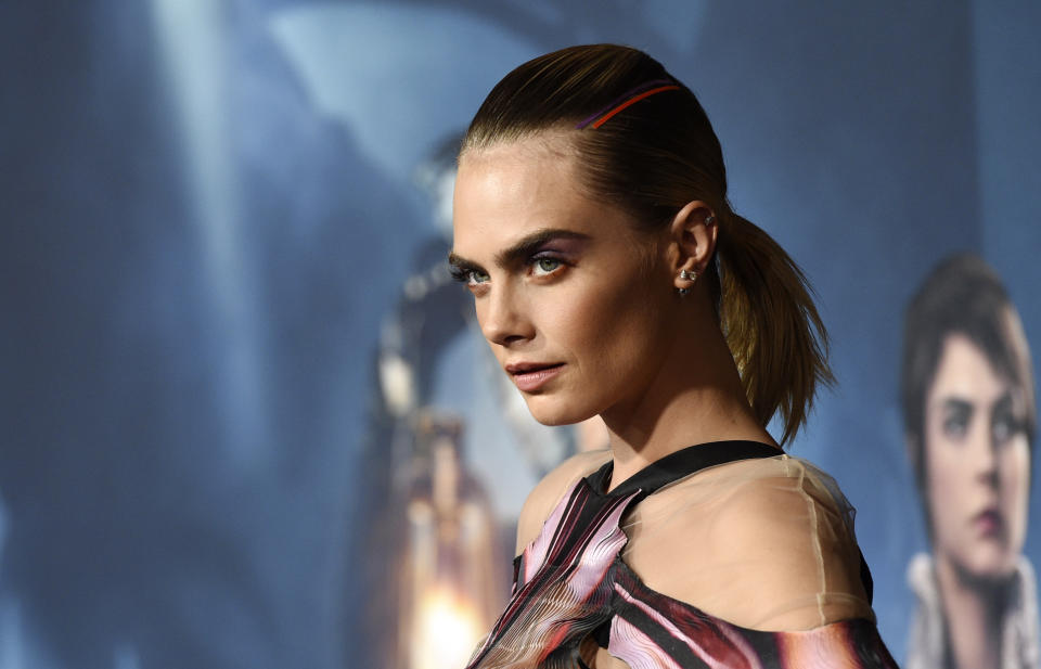 """Cara Delevingne, a cast member in the Amazon Prime Video series """"Carnival Row,"""" poses with his wife Emma at the premiere of the series at the TCL Chinese Theatre, Wednesday, Aug. 21, 2019, in Los Angeles. (Photo by Chris Pizzello/Invision/AP)"""