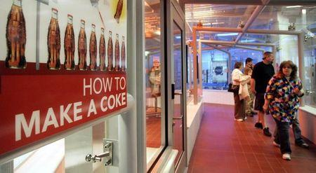 Tourists walk through the the bottling section at the World of Coca-Cola to see how Coca-Cola is made in Atlanta.