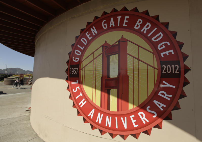 "In this photo taken Wednesday, April, 18, 2012, a logo marking the 75h annivsary is painted on the restored Round House at the Golden Gate Bridge in San Francisco. It served as a picturesque backdrop for Jimmy Stewart and Kim Novak's tensely romantic first meeting in ""Vertigo"" in 1958, made the cover of Rolling Stone in the '70s and was nearly decimated by a falling Romulan drill-of-death in 2009's ""Star Trek."" One way or another, the Golden Gate Bridge has packed a lot of history into its 75-year span. (AP Photo/Eric Risberg)"